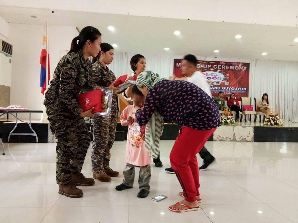 Military officers helped in distributing the Nutri10Plus Syrup and DayCee pouches to the kids